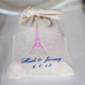 The couple stuffed mini bags that had the Eiffel Tower on them with candies and chocolates for a touch of Paris in St. Louis.
