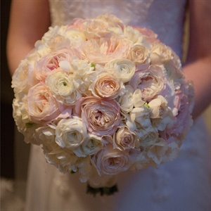 Leeanne carried a rounded bouquet of peonies, roses, freesia, ranunculus and hydrangeas.