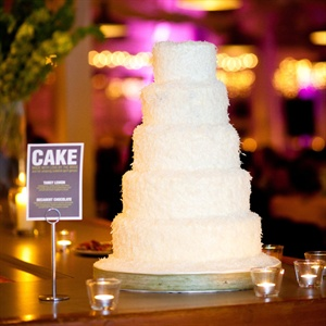 Nicole actually made her own wedding cake with the help of her bridesmaid. The five-tiered confection was topped with vanilla Swiss buttercream and shredded coconut.
