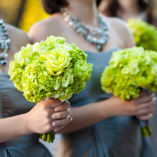 The girls carried bright green bunches of hydrangeas and roses.