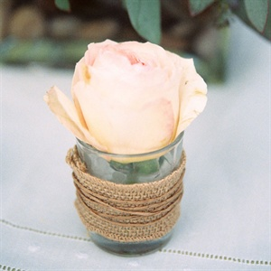 The outdoor tables were decorated with roses in a soft peachy pink palette.