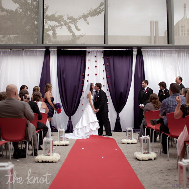Deep-purple and silver draping, along with hanging carnations, served as the ceremony backdrop.
