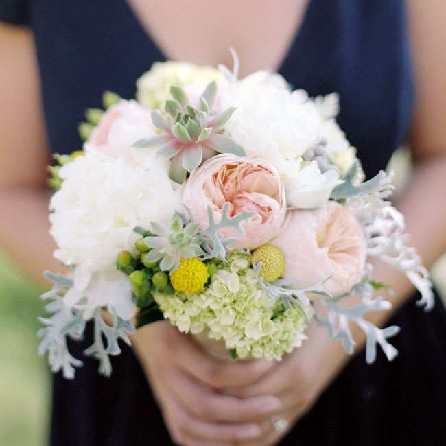 The bridesmaids bouquets had mini-green hydrangeas, green hypericum berry, dusty miller, silver brunia berry, white peony, billy balls, and coral garden rose wrapped in burlap.
