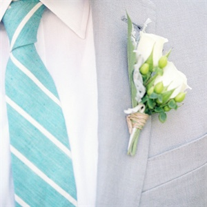 The groom wore a J.Crew tie in light blue with a white diagonal stripe.