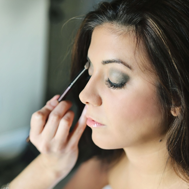 "Megan wanted a simple look for her wedding day so she chose a green eye shadow to emphasize her brown and eyes and waterproof mascara was needed since she says she was a ""huge ball of emotion."""