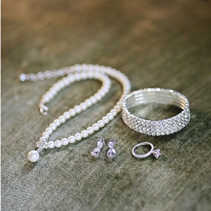 Megan says that Pearls are a must for a southern wedding and Micah was the one who picked the necklace out. Megan kept her jewelry simple yet elegant for her southern look.
