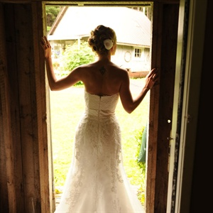 Audra's dress had a sweetheart, strapless neckline, strapless and was made of silk, chiffon, and lace in cream. The train was a bit longer and was so beautiful, until it got covered in mud. Audra and her bridesmaids wore pashmina's too because it was sprinkling and chilly.