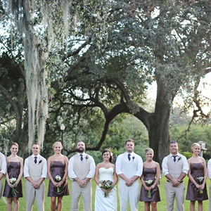 When deciding on the look for the entire bridal party the weather was the first thing they considered. They knew it would be extremely hot so Megan chose short brown dresses for the bridesmaids. The groomsmen wore matching khaki suits without the jackets and rolled up their sleeves for a casual look.