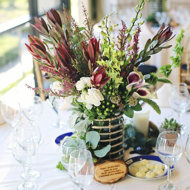 Megan and Micah carried their natural theme throughout the reception including the centerpieces which sat in willow vases. They carved eighteen fun facts about themselves into wood and place two at each table.