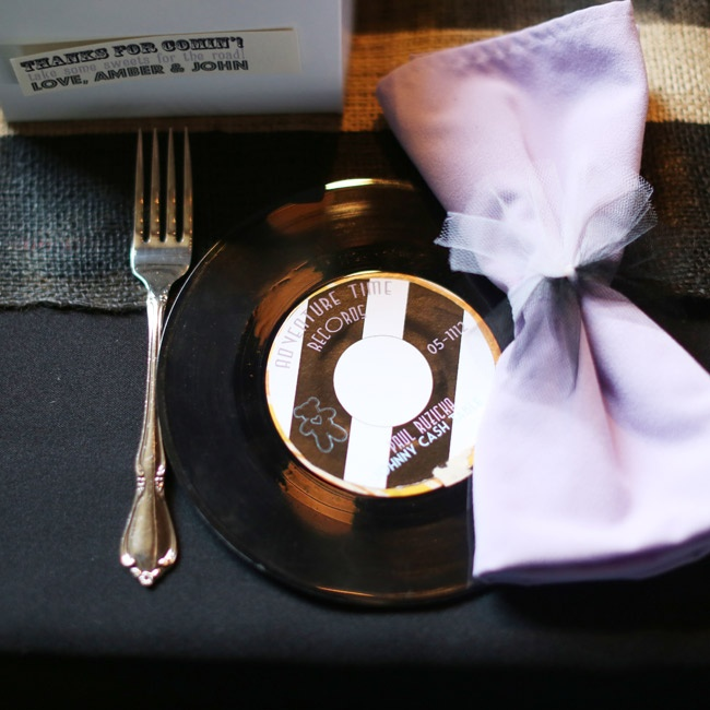 The couple's place cards were 45rpm records. Soft purple napkins added elegance to each guest's seat.