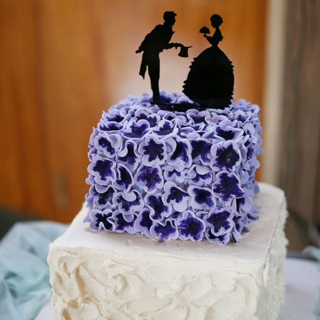 Amber's little sister actually made the two-tiered buttercream and fondant wedding cake. She finished it with a black silhouette cake topper.