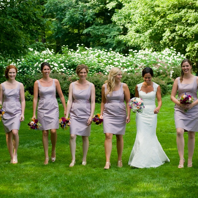 Even though Amanda told her bridesmaids they could choose whatever style dress they wanted from the J.Crew, Cotton Cady line (as long as it was the lavender color), but they ended up all choosing the same style! Amanda also let her bridesmaids choose whatever color shoes but they all ended up going with a gold color shoe in different styles.