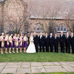The bridesmaids all wore eggplant-purple short one-shouldered dresses and covered up with champagne pashminas. The guys wore black tuxedos and champagne vests and bowties to match the ladies.