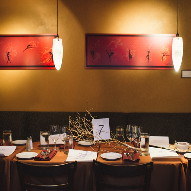 Elizabeth and Rob provided the restaurant with metallic painted manzanita branches purchased on Etsy that were laid across each table and the table numbers rested on the branches.