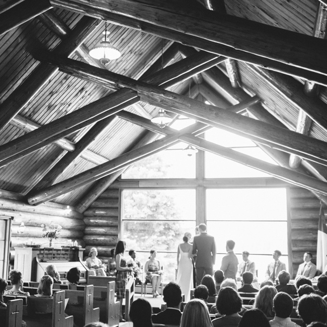 Elizabeth and Rob were married in a historic one room log cabin church called Chapel by the Lake. Elizabeth had given tours as a 14 year old of the space to tourists and from that age knew she knew she  wanted to get married there.