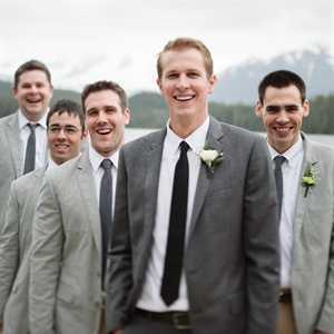 Rob had seven groomsmen. Rob wore the Ludlow Suite from J.Crew in charcoal. and the groomsmen wore grey striped blazers also from J. Crew and matching J.Crew ties.