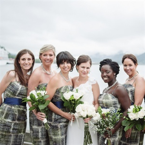 The bridesmaid's wore strapless patterned dress of navy, gray and green from Anthropologie and accessorized with,grey pearls, navy sashes and nude pumps.