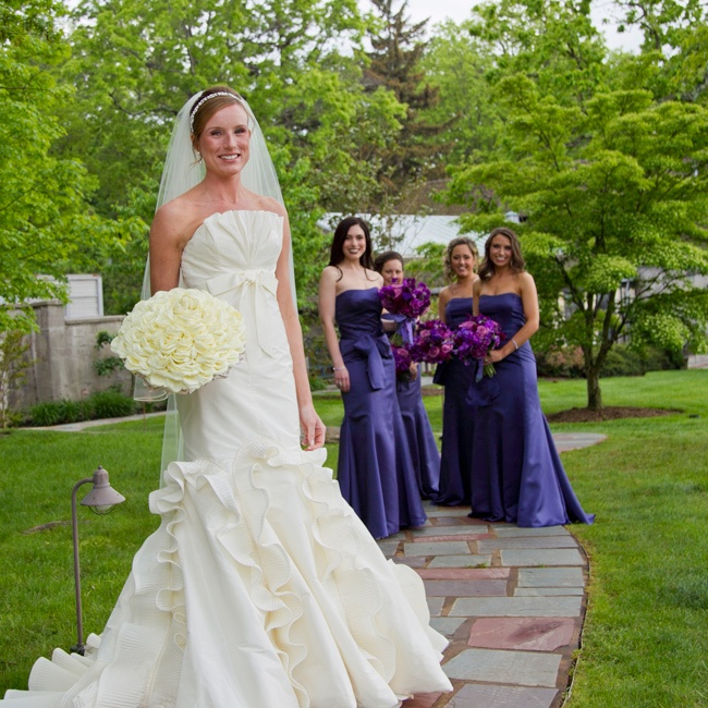 Pleated ruffles on the lower half of her gown delivered exactly the right amount of wow Cherylynne was after. The bridesmaids also wore Vera Wang gowns but in deep purple.