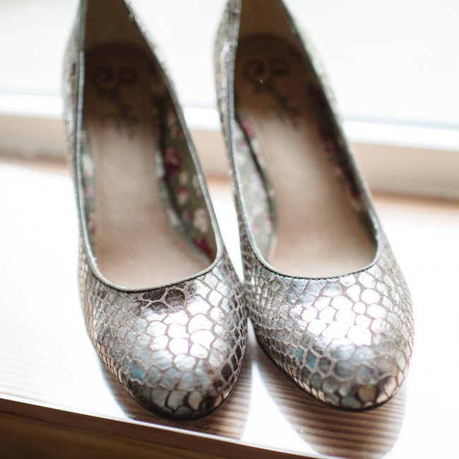 "Elizabeth wore silver pumps by Seychelles. ""I wear the same shoes almost everyday to work in a different color,"" said the bride, ""and I wanted something I KNEW were comfortable."""