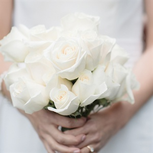 Juneau has to import all their cut flowers so Elizabeth and Rob knew they weren't going to have a flower-centric wedding. Elizabeth arranged her own bouquet of ivory roses that complimented the ivory rosettes on her gown.