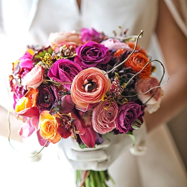 Crimson dahlias, wine-colored orchids and pink spray roses made up Emily's textured bridal bouquet.