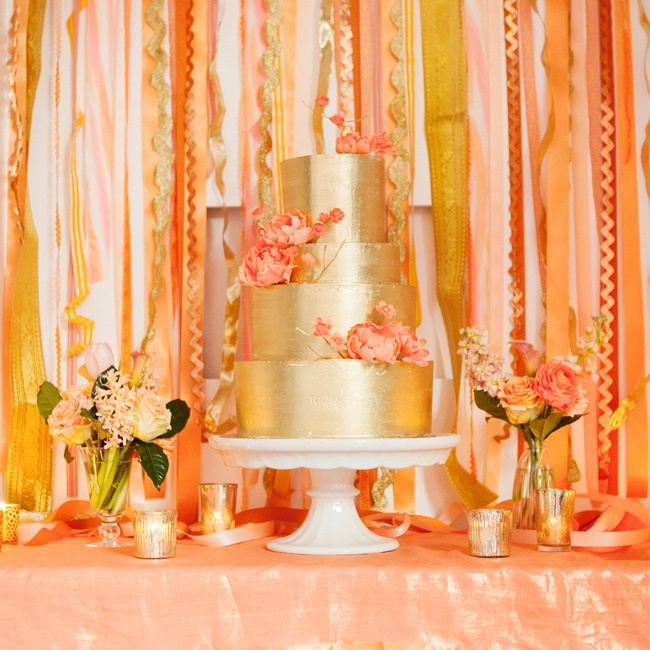 Vibrant vintage ribbons did double duty—they drew attention to the stunning cake while camouflaging a not-so-interesting part of the room.
