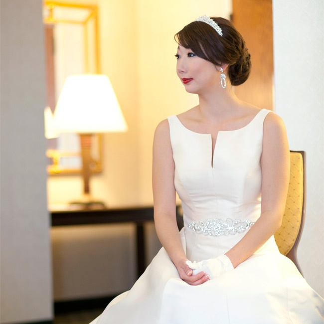 Emily wanted an Audrey Hepburn-esque look for her wedding. This ivory silk gown with a bateau neckline fit the bill.