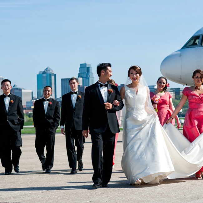 The bridesmaids wore striking coral dresses with cap sleeves, while the guys donned classic black tuxes.