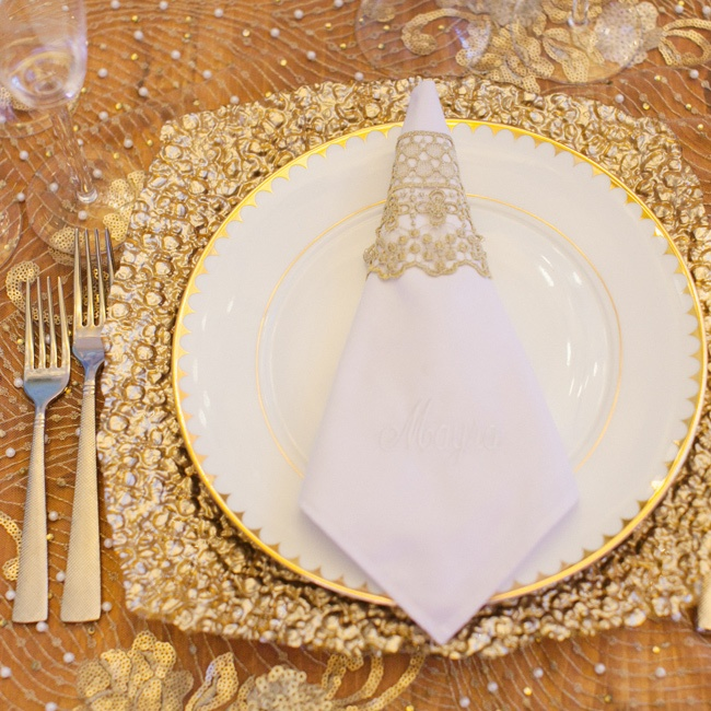 A little bit rustic, a whole lot of glam: That was the goal when Mayra's team topped wooden farmhouse tables with metallic lace fabric, molten-gold chargers and delicate white china.