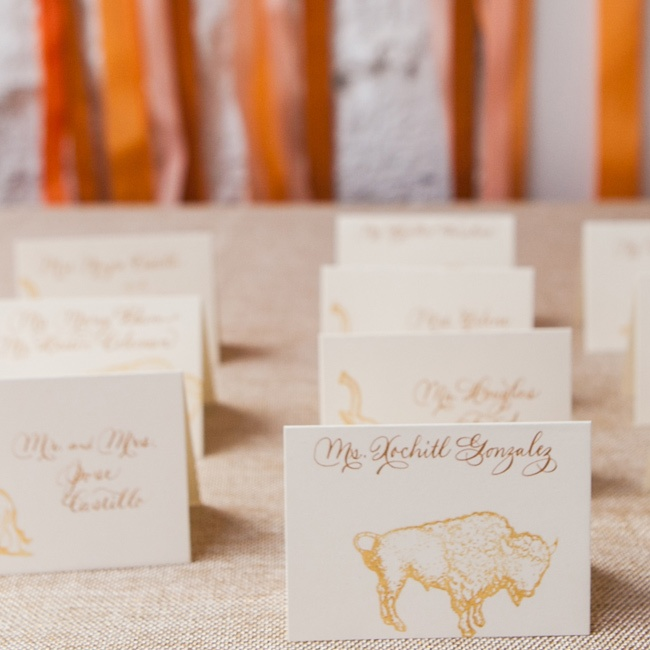 Calligraphed cards hand-stamped with a buffalo, an elephant or a horse guided guests to their tables.