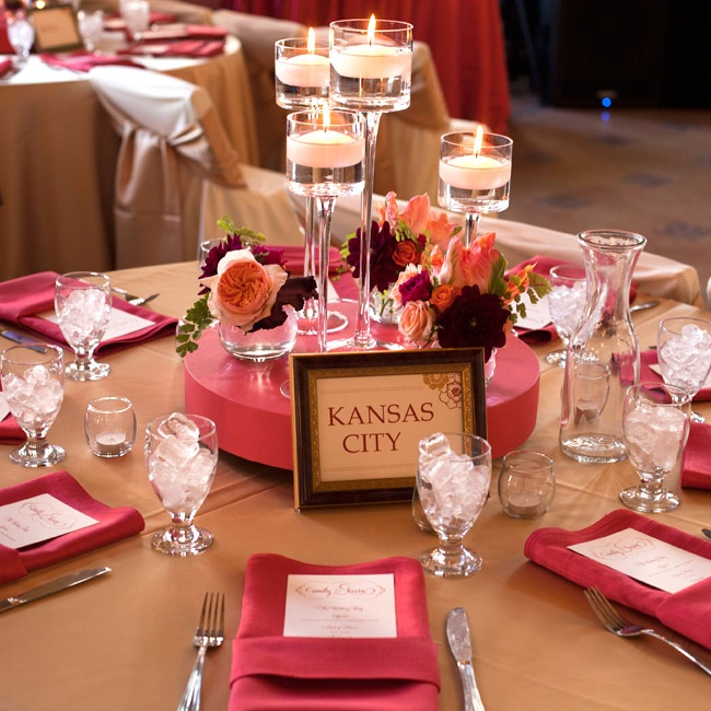Fresh flowers and varying heights of candles formed interesting centerpiece displays. Each table was named after a different city or country the couple had traveled to.