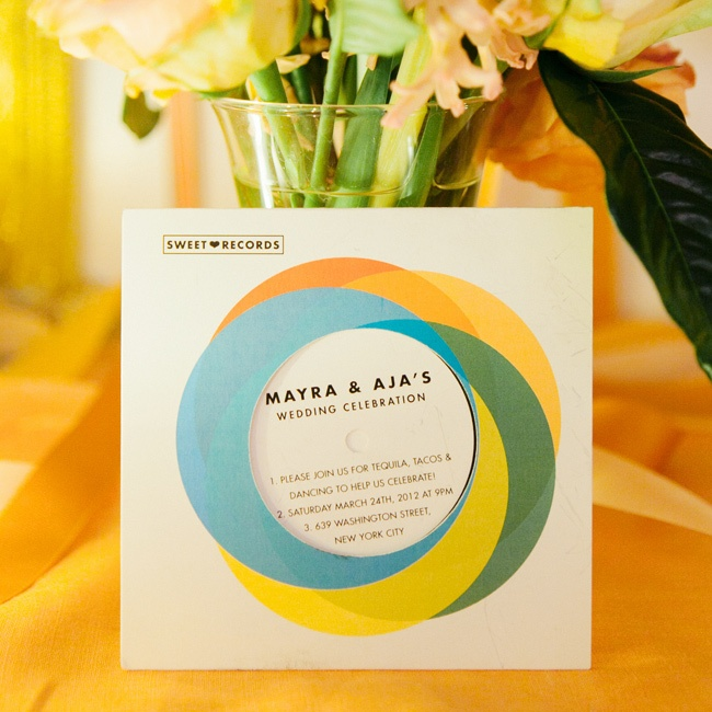 The couple got creative with their wedding invites and sent out a personalized record to announce the occasion.