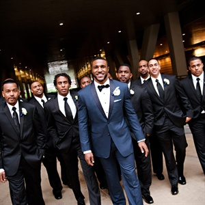 Ryan wore a handsome navy tux with a black bow tie, while the groomsmen all looked classic in black tuxedos and ties.