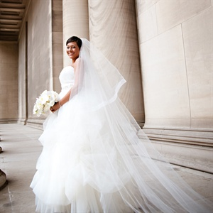 Jillian looked stunning in a princess-like ball gown. She wore an elegant veil to complete the look.