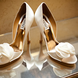 Jillian loved the flower detail on the front of her ivory peep-toe heels.
