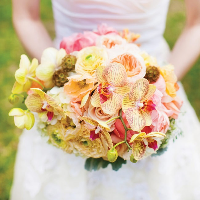 Claire's garden rose, orchid, ranunculus and scabiosa pod bouquet embodied the wedding's fresh garden feel.