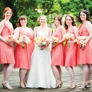All of Claire's bridesmaids agreed they could wear these pink V-neck dresses again after the wedding.