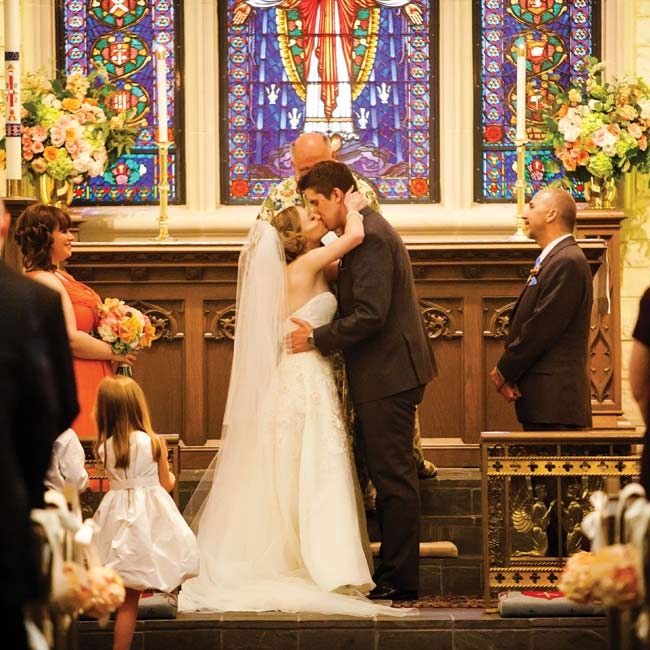 Floral arrangements in colors that complemented the church's stained glass decorated the altar.