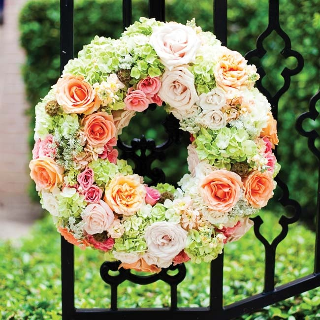 Wreaths of flowers on the church gates signaled to guests that they were in the right place.