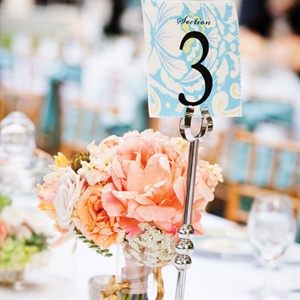 The same fabrics from the escort card display served as canvases for the ironed-on table numbers.