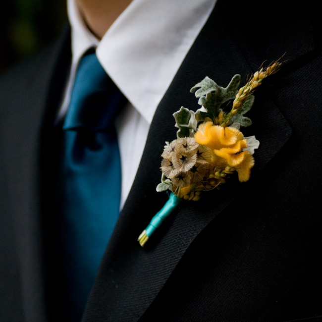The guys wore locally-sources scabiosa pods, coxcomb and dusty miller.