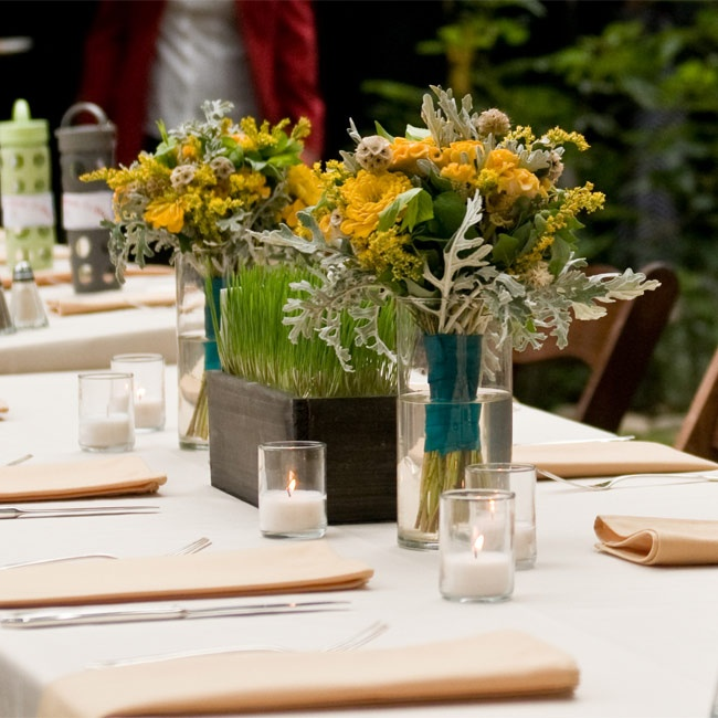 Each table had a box of fresh wheat grass that the couple grew. Coxcomb, dusty miller and scabiosa pods surrounded the green arrangements.