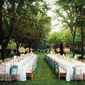 Two long tables, which seated 75 guests each, echoed the long lines of trees in the outdoor sculpture garden.
