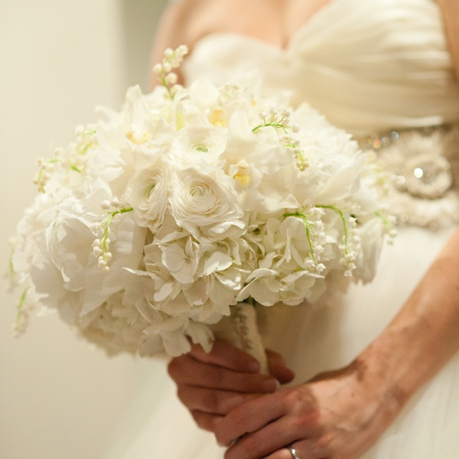 LIlies of the valley added texture to the all-white bouquet of peonies, ranunculus and roses.