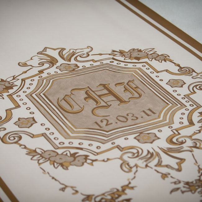 A custom-made runner with the couple's new monogram made for a regal entrance into the reception tent.