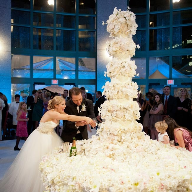 "The nearly six-foot-tall sugar flower cake sat on a table of real blooms. ""We couldn't tell where the cake ended and the real flowers began!"" Chandler says."
