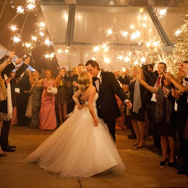 The couple ran through a tunnel of guests holding sparklers on their way to their getaway car.