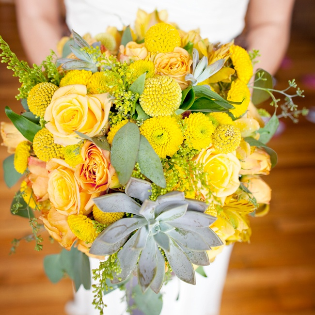 Allison carried a yellow bouquet made of garden roses, billy balls, seeded eucalyptus, alstroemerias, lilies, solidagos and succulents.