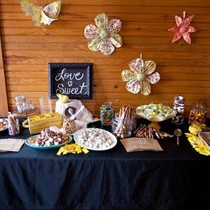 The Candy table was in honor of the brides daughter, Sailor, and was decorated with paper flowers and butterflies with various candies and homemade treats with guests to take home.