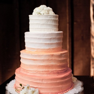 The four-tiered ivory to peach cake was topped with fresh flowers.
